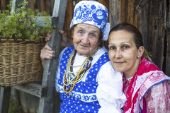Grandmother and her daughter in ethnic clothes outdoor . Stock Images