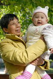 Grandmother and her  grandchild. A chinese grandmother and her  grandchild Stock Photo