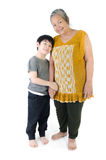 Grandmother with her grandchild. Portrait of Grandmother with her grandchild isolated on white background Stock Photo