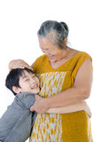 Grandmother with her grandchild. Portrait of Grandmother with her grandchild isolated on white background Royalty Free Stock Photos