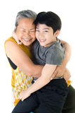 Grandmother with her grandchild. Portrait of Grandmother with her grandchild isolated on white background Royalty Free Stock Photo