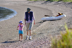 Grandmother and her grandchild walks on the beach. Of Royalty Free Stock Photography