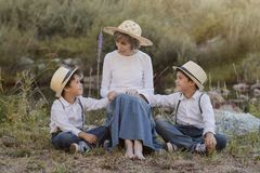 Grandmother with her grandchildren stock photos