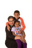 Grandmother and her grandchildren isolated against a white background. Room for copy space royalty free stock photo