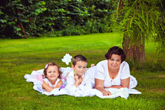 Grandmother and her grandchildren in the park Stock Photos