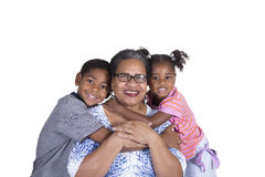 A grandmother and her grandchildren. On white Stock Photos
