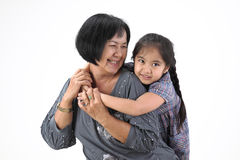 Grandmother with her grandchildren. On white background stock photos