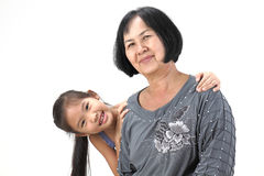 Grandmother with her grandchildren. On white background royalty free stock photo