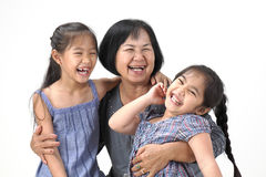 Grandmother with her grandchildren. On white background stock photography