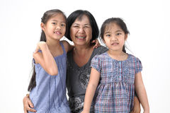 Grandmother with her grandchildren. On white background royalty free stock photos