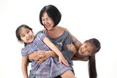 Grandmother with her grandchildren. On white background royalty free stock image