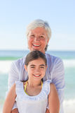 Grandmother with her granddaughter. Looking at camera Stock Photos