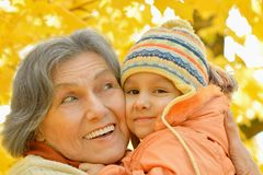Grandmother with her granddaughter. In the autumn park Stock Photography
