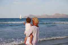 Grandmother with her granddaughter. Grandmother with a little granddaughter on the beach Royalty Free Stock Photos