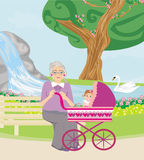 Grandmother with her granddaughter for a walk in the park Royalty Free Stock Images