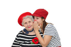 Grandmother and her granddaughter whispering Royalty Free Stock Image
