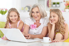 Grandmother and her granddaughters Stock Photography