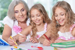 Grandmother and her granddaughters Stock Images