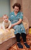 Grandmother with her grandson on bed Royalty Free Stock Photos