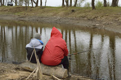 Grandmother with her grandson fishing rod. At river stock images