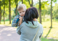 Grandmother with her grandson in her arms Royalty Free Stock Photography