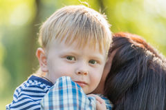 Grandmother with her grandson in her arms Royalty Free Stock Images