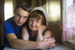 Grandmother with her grandson in the house posing for the camera. Love. Stock Image
