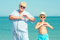 Grandmother with her grandson are resting on the sea.Love to the sea. royalty free stock photography