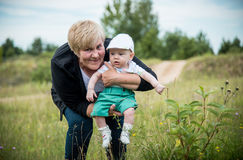 Grandmother and little grandson posing outdoors Stock Photography
