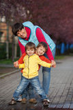 Grandmother with her two grandchildren Royalty Free Stock Photo