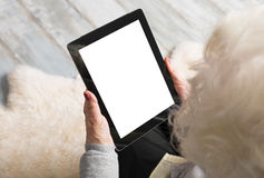 Grandmother holding blank screen tablet Royalty Free Stock Photo