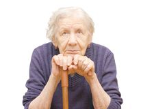 Grandmother holding a cane. On white background Stock Images