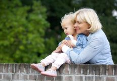 Grandmother holding cute baby girl Stock Photography