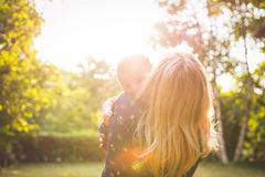 Grandmother holding grandchild on a sunny day Royalty Free Stock Images