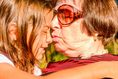 Grandmother  holding her Granddaughter. Grandmother is holding her Granddaughter Royalty Free Stock Photo