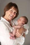 Grandmother Holding Newborn Baby royalty free stock photo