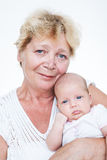 Grandmother holding newborn baby Stock Photography