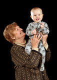 Grandmother holding young toddler Stock Image