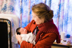 Grandmother holds newborn baby at the hospital Stock Images