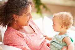 Grandmother At Home Playing With Granddaughter In Garden Stock Images