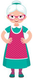 Grandmother a housewife in an apron in full growth on a white  Royalty Free Stock Photos