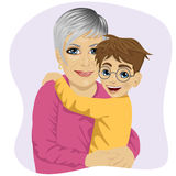 Grandmother hugging her cute grandson Royalty Free Stock Photo