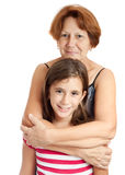 Grandmother hugging her granddaughter. Hispanic grandmother hugging her granddaughter isolated on a white background Stock Photography
