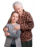 Grandmother hugging her granddaughter Royalty Free Stock Image