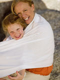 A grandmother hugging her granddaughter. Stock Image