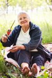 Grandmother with kebab in hand Royalty Free Stock Photo
