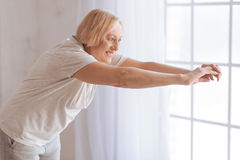 Grandmother keeping her body fit Royalty Free Stock Images