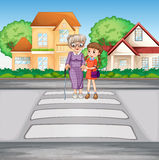Grandmother and kid crossing the road Stock Photography
