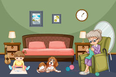 Grandmother with kid and dog in room Royalty Free Stock Photography