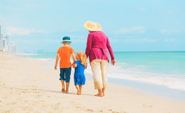 Grandmother with kids- little boy and girl- at beach stock photos
